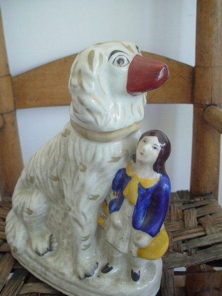Staffordshire figurine of a spaniel dog and a young boy