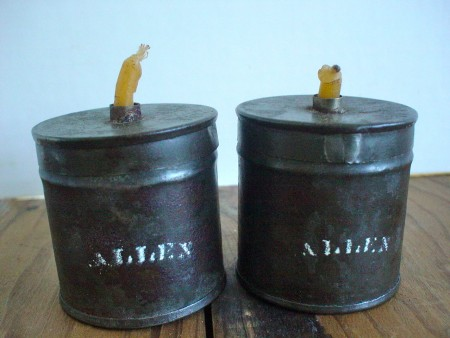 A matched pair of tin wax jacks, marked Allen