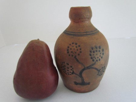 A 6 inch Redware Jug with paint decoration