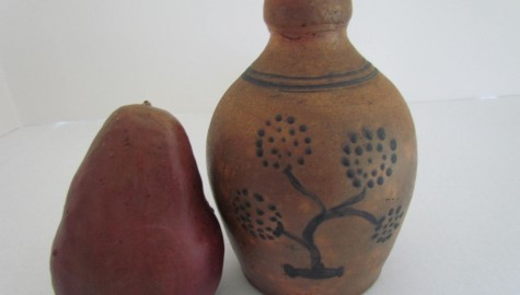 A 6 inch Redware Jug with paint decoration/Red Wing