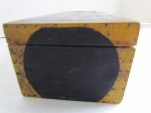 mustard painted box_with black circles